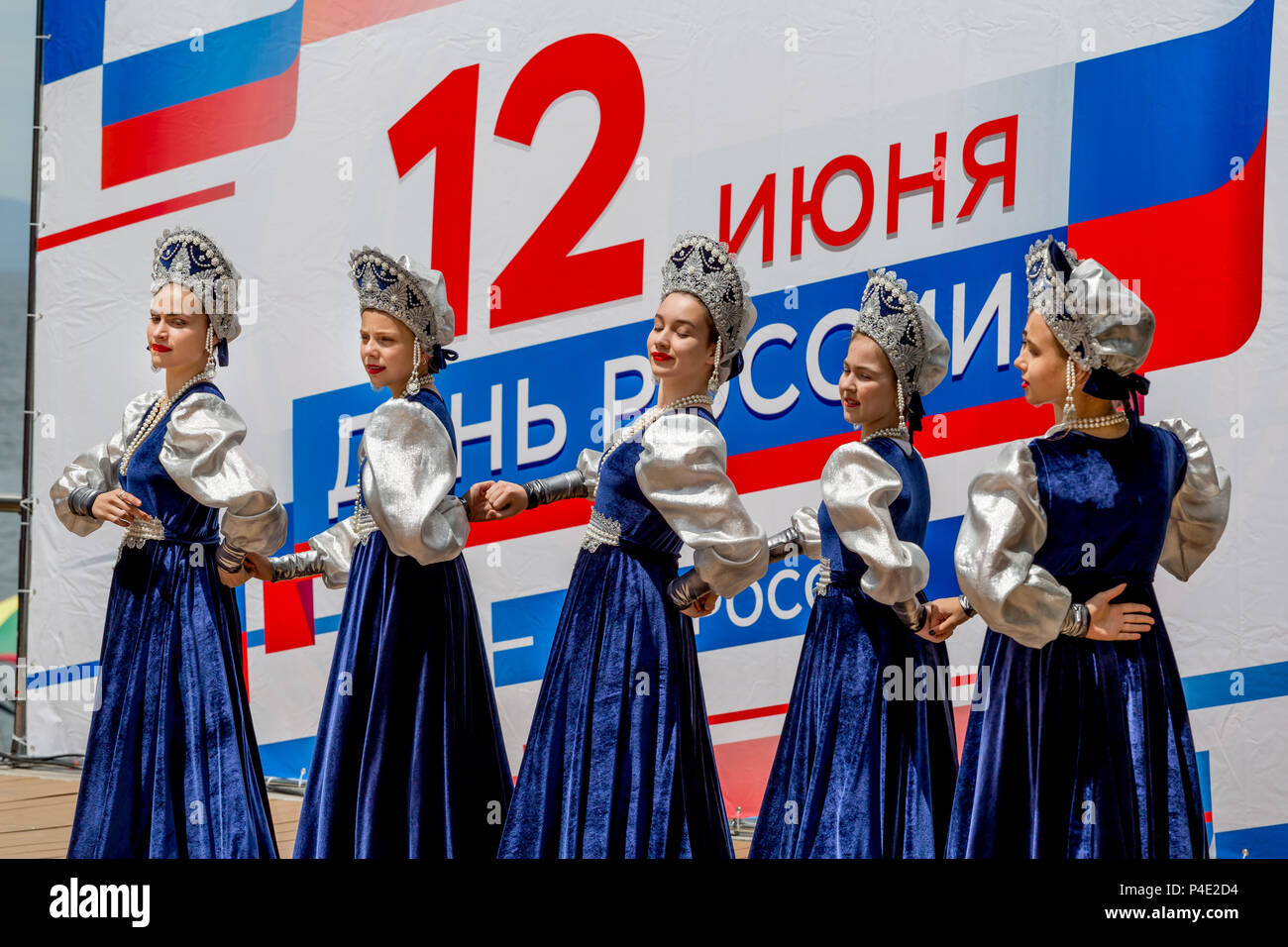 Russia, Vladivostok, 06/12/2018. Beautiful ladies in traditional Russian costumes perform on stage in a honor of Russia Day. Annual celebration Russia - Stock Image