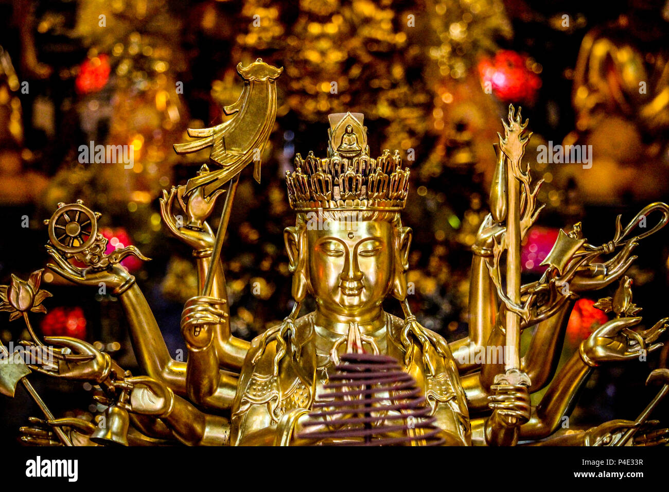 Hanoi, Vietnam - March 15, 2018: Detail of a golden Buddha statue at the interior of the One Pillar Pagoda, one of Hanoi's landmarks - Stock Image