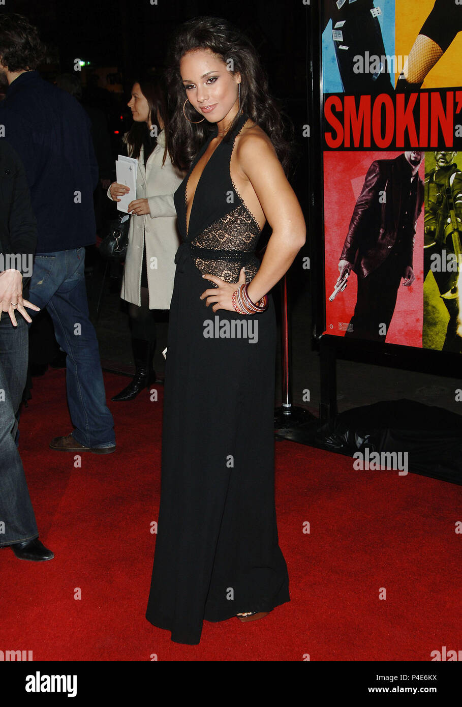 Alicia Keys arriving at the Smokin' Aces at the Chinese Theatre In Los Angeles. January 18, 2007.  smile full length black dress side view03_KeysAlicia035 Red Carpet Event, Vertical, USA, Film Industry, Celebrities,  Photography, Bestof, Arts Culture and Entertainment, Topix Celebrities fashion /  Vertical, Best of, Event in Hollywood Life - California,  Red Carpet and backstage, USA, Film Industry, Celebrities,  movie celebrities, TV celebrities, Music celebrities, Photography, Bestof, Arts Culture and Entertainment,  Topix, vertical, one person,, from the year , 2007, inquiry tsuni@Gamma-USA - Stock Image