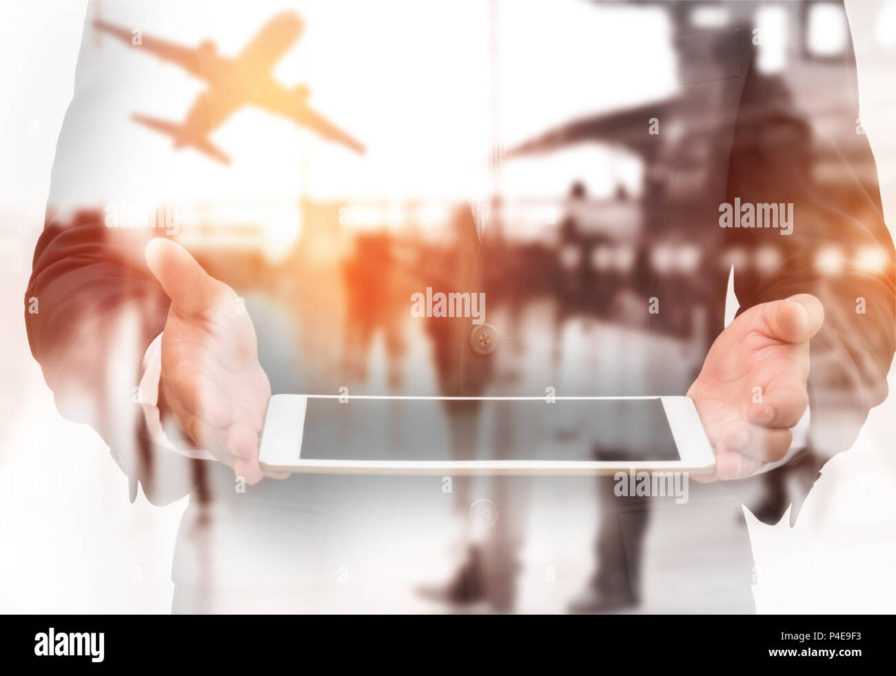 Double exposure businessman holding tablet on hand with blurred terminal airport background. Transportation and Travel airline concept. - Stock Image