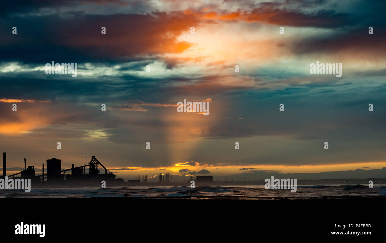 Redcar sunset with industrial background. Redcar is located on the north east coast of England. - Stock Image