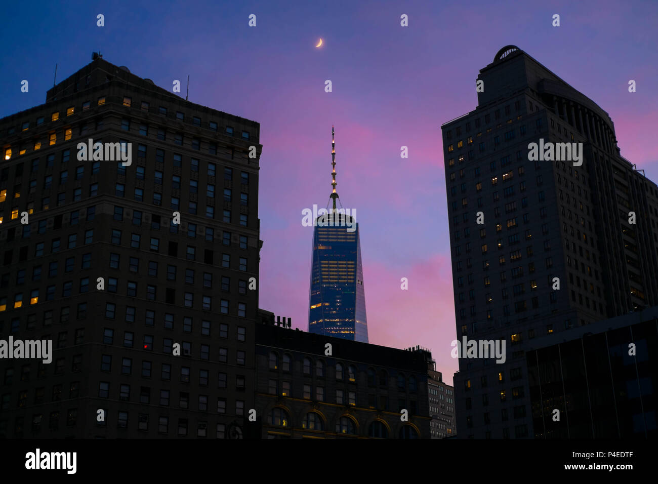 Downtown Manhattan and One World Trade Center at sunset. Taken from Chinatown. - Stock Image