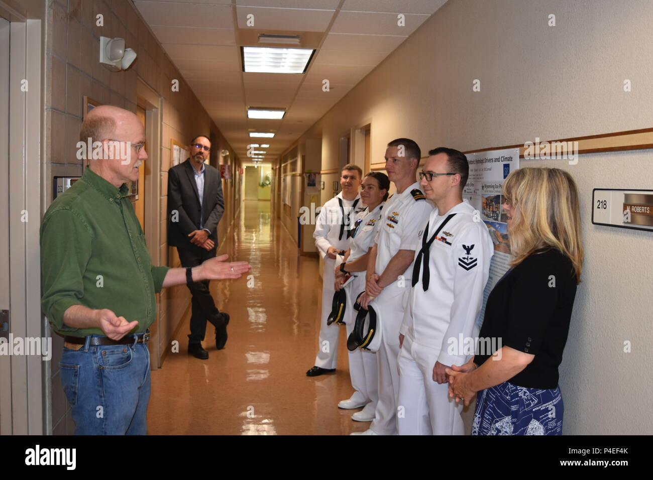 Dr. Joe McConnell from the Desert Research Institute in Reno speaks with members from the U.S. Navy's Meteorology and Oceanography Command about the process of drilling ice core samples and how they reveal the impact of humans on the environment going back thousands of years. - Stock Image