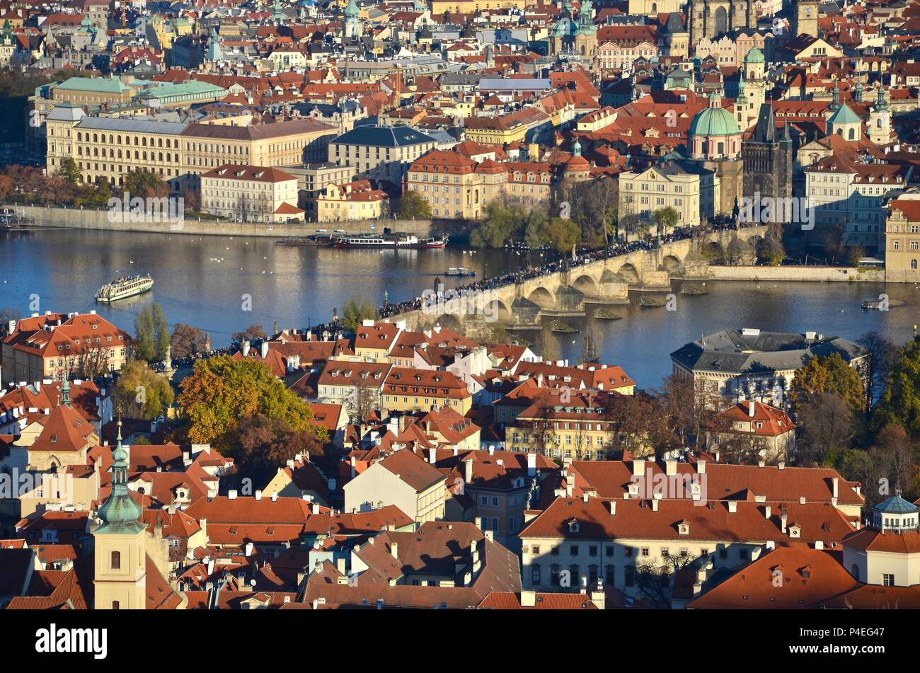 Old town Prague by day with view towards Charles Bridge and river Moldau, people, Czech republic - Stock Image