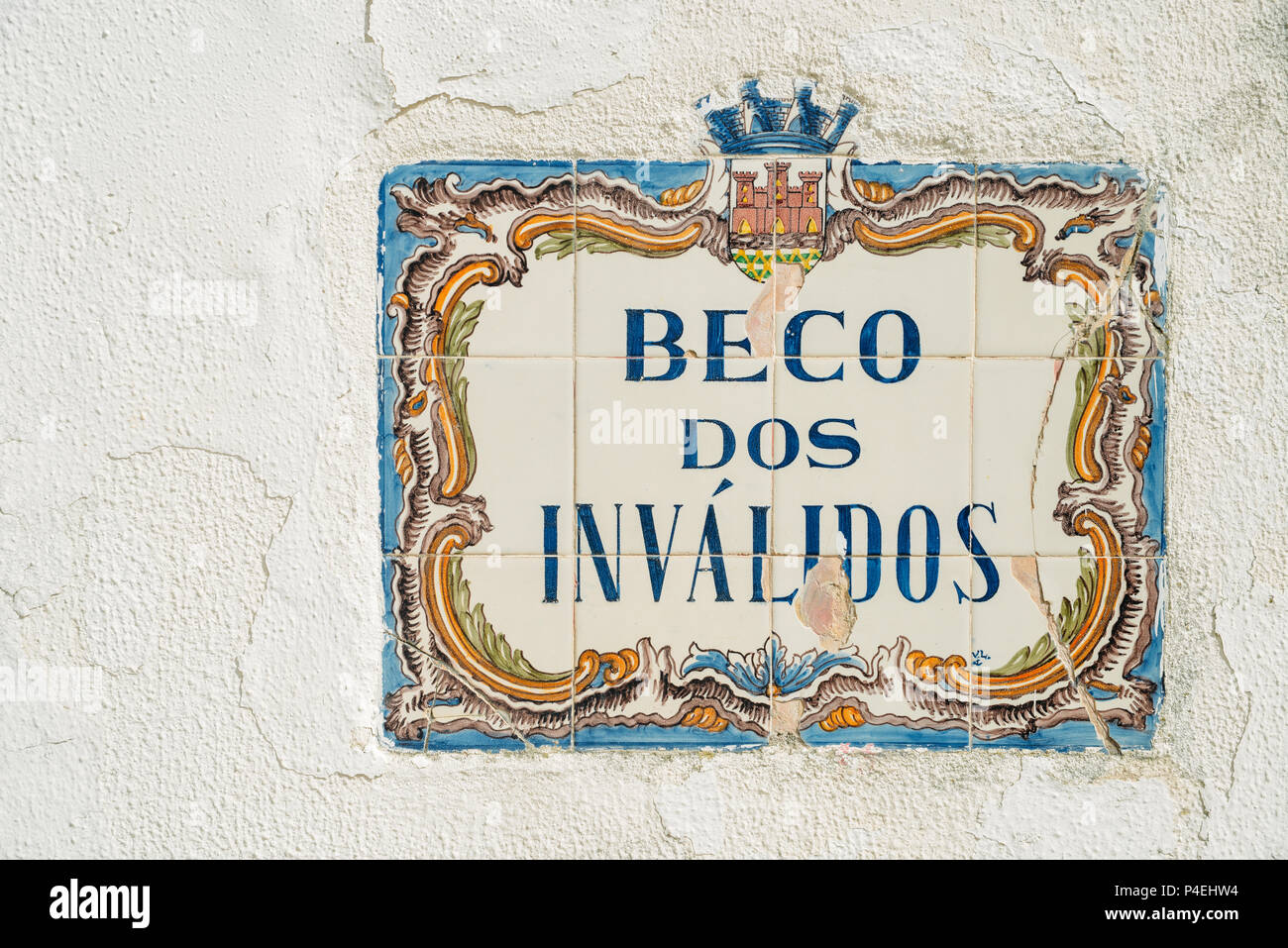 A traditional street sign in the historic centre of Cascais. Beco dos Invalidos means, alleyway of the handicapped - Stock Image