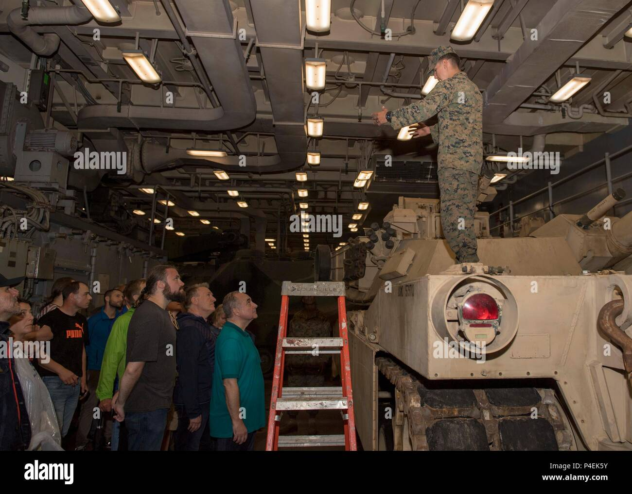 180616-N-PC620-0050  KIEL, Germany (June 16, 2018) U.S. Marine Cpl. Jonathan Klein, from San Antonio, gives a tour of an M1A1 Abrams tank, attached to the 26th Marine Expeditionary Unit, aboard the Harpers Ferry-class dock landing ship USS Oak Hill (LSD 51), in Kiel, Germany, during Kiel Week 2018, June 16. Oak Hill, home-ported in Virginia Beach, Virginia, is conducting naval operations in the U.S. 6th Fleet area of operations. (U.S. Navy photo by Mass Communication Specialist 3rd Class Michael H. Lehman/Released) Stock Photo