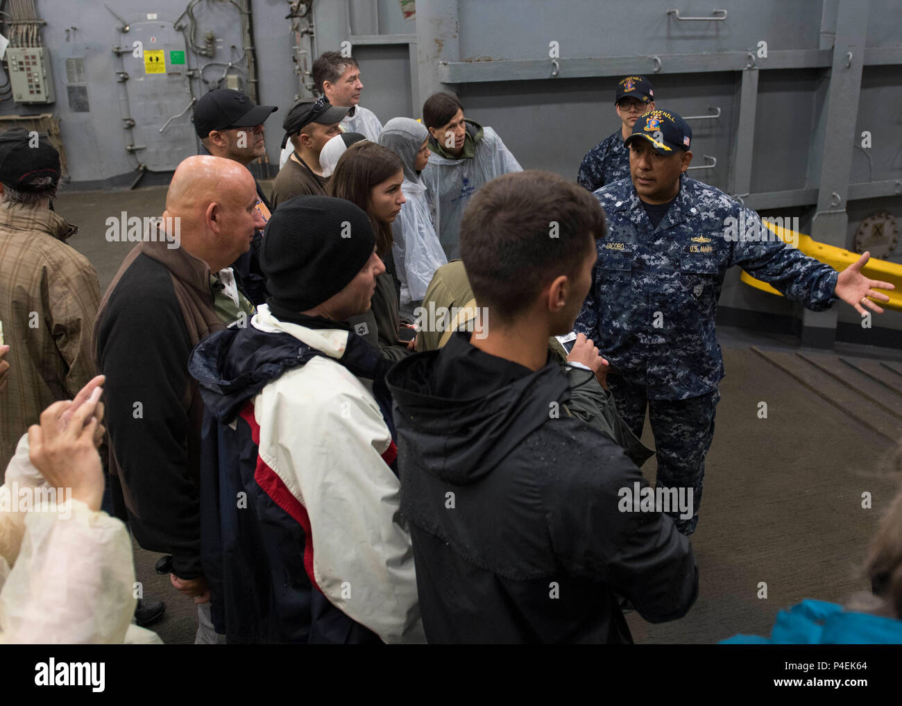 180616-N-TJ319-0121  BALTIC SEA (June 16, 2018) Cmdr. Rod Jacobo, executive officer of the Harpers Ferry-class dock landing ship USS Oak Hill (LSD 51), gives a tour of the ship in Kiel, Germany, during Kiel Week 2018, June 16. Oak Hill, home-ported in Virginia Beach, Virginia, is conducting naval operations in the U.S. 6th Fleet area of operations. (U.S. Navy photo by Mass Communication Specialist 3rd Class Jessica L. Dowell/Released) Stock Photo