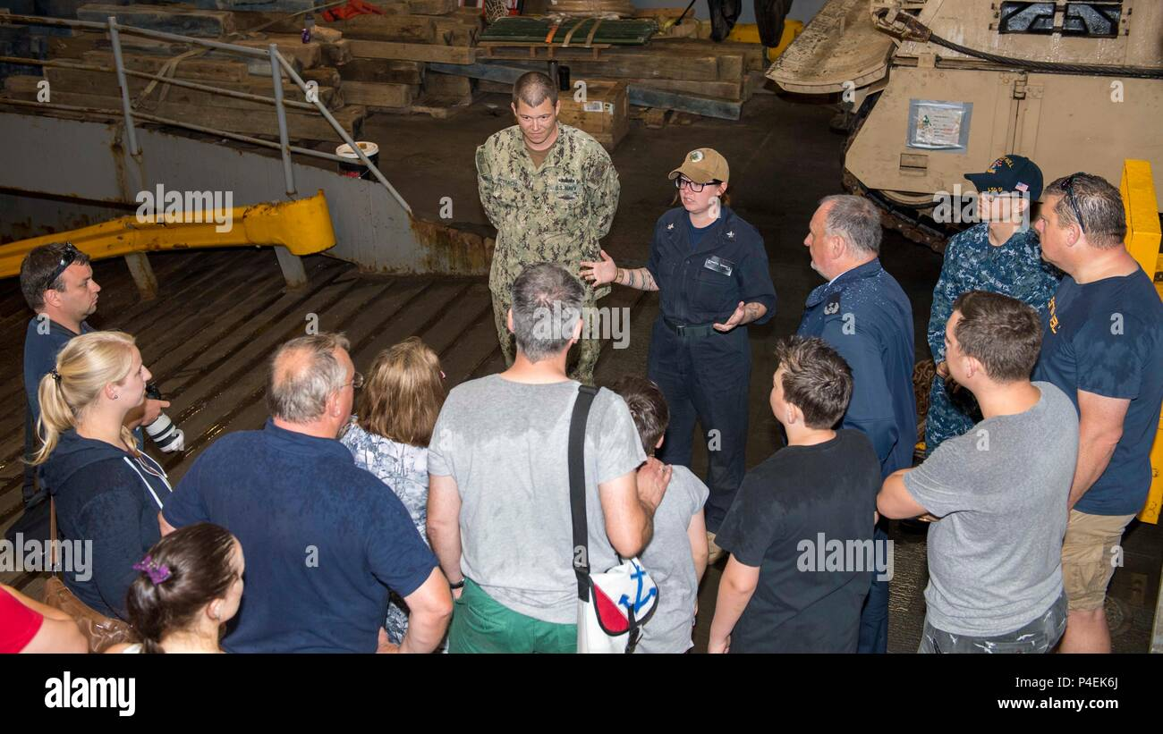 180616-N-PC620-0030  KIEL, Germany (June 16, 2018) Boatswain's Mate 2nd Class Brooke Bagatta, from Liberty, New York, gives a tour of the Harpers Ferry-class dock landing ship USS Oak Hill (LSD 51) in Kiel, Germany, during Kiel Week 2018, June 16. Oak Hill, home-ported in Virginia Beach, Virginia, is conducting naval operations in the U.S. 6th Fleet area of operations. (U.S. Navy photo by Mass Communication Specialist 3rd Class Michael H. Lehman/Released) Stock Photo