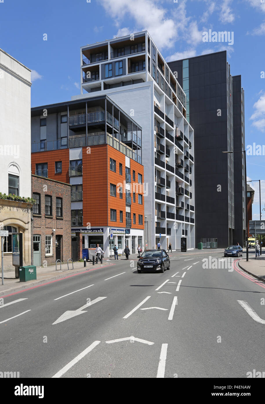 New apartment blocks on Sutton Court Road in Sutton, Surrey, UK. Shows cars on the one-way system in the foreground. - Stock Image
