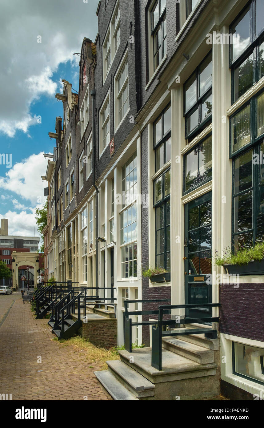 Facades of 17th century waterfront houses in Amsterdam. Stock Photo