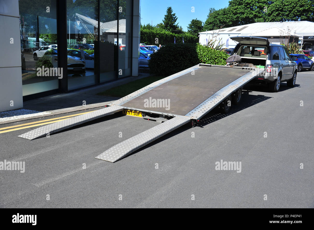 Large Car Trailer With Ramps Lowered Ready For Loading A Car Stock