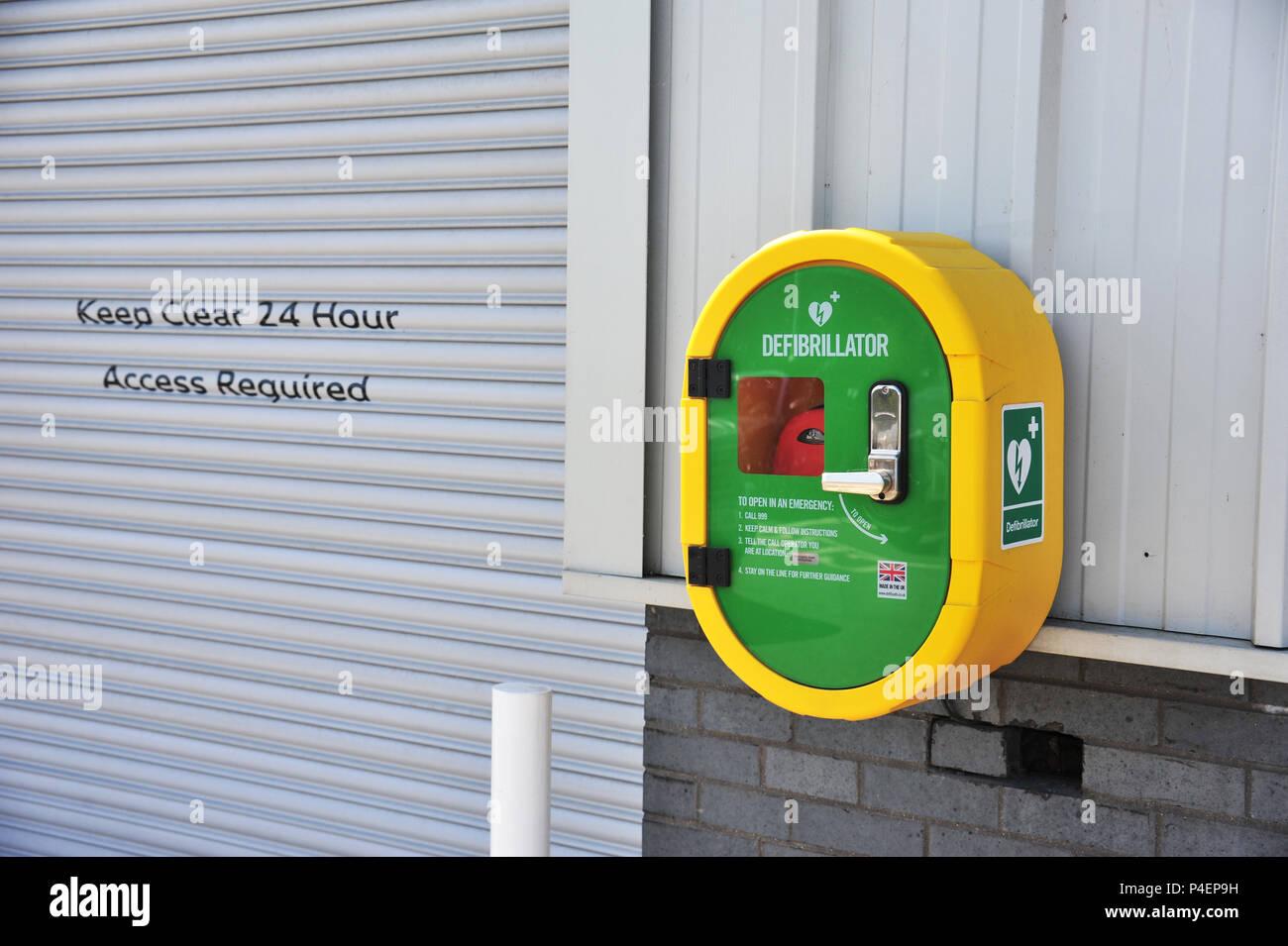 Life saving Defibrillator on the wall of the Audi Car Showroom - Stock Image