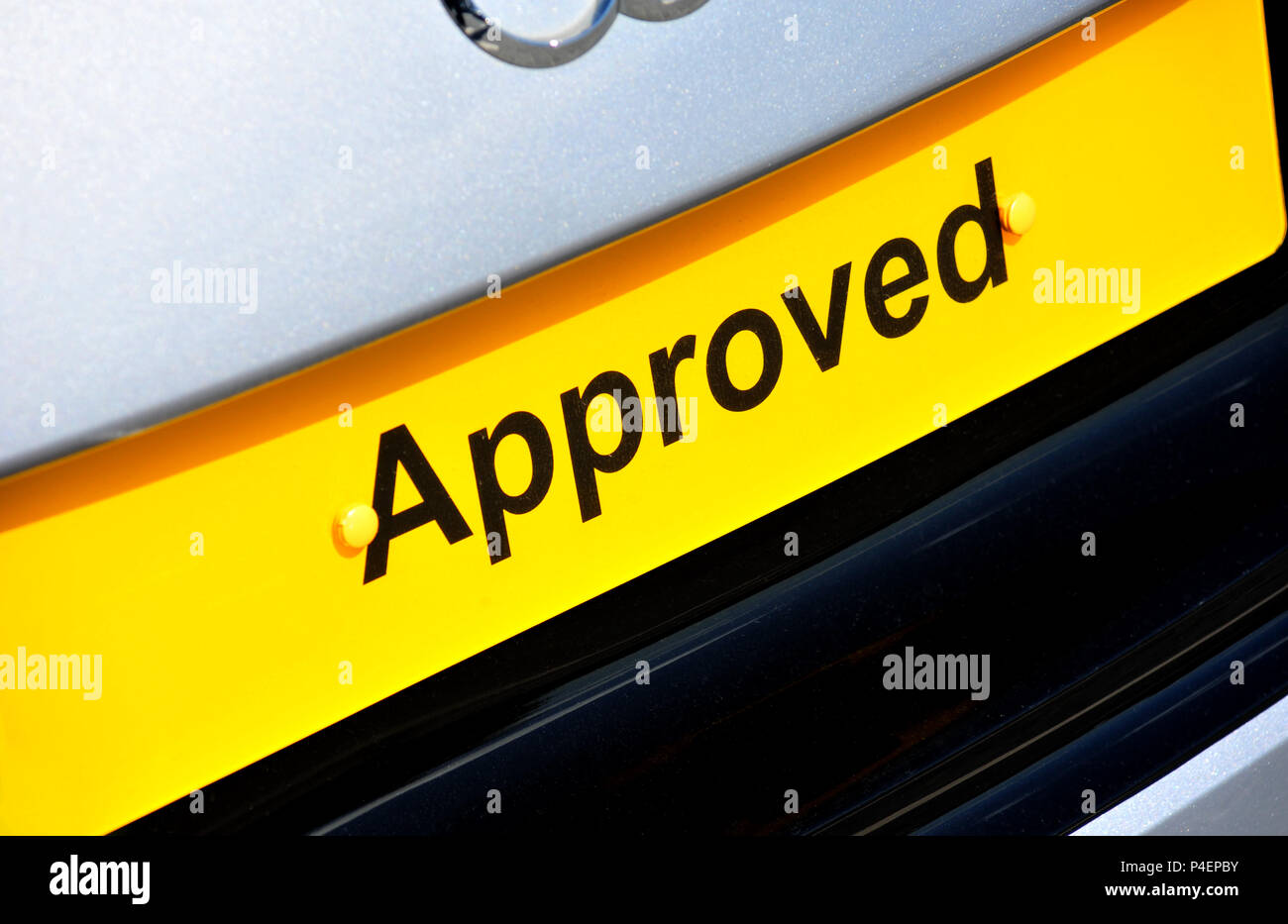 Yellow Approved car plate on an Audi at a dealership in the uk - Stock Image