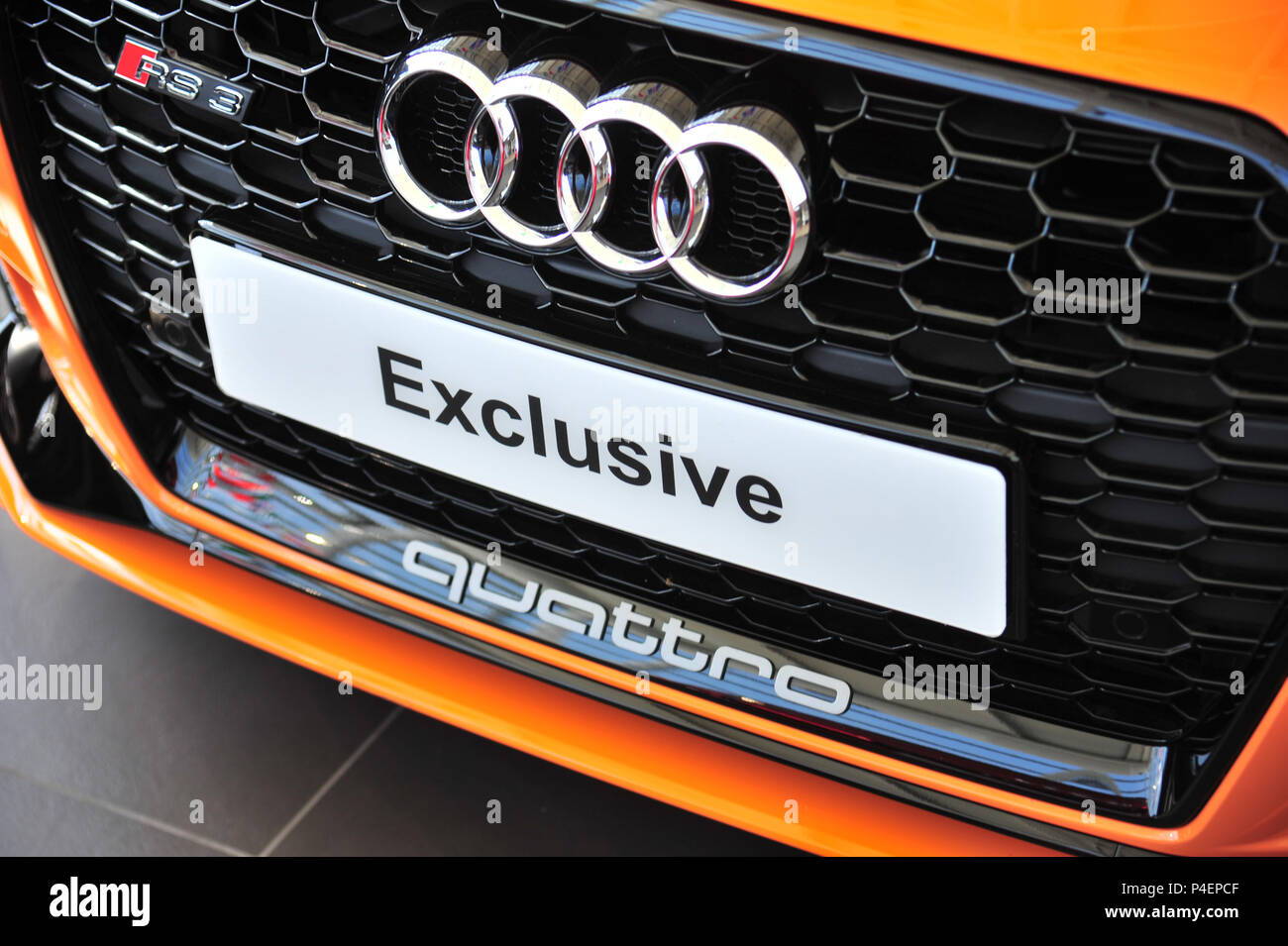 Close up of yellow Audi Quattro car grill on sale at Audi dealership in the uk Stock Photo