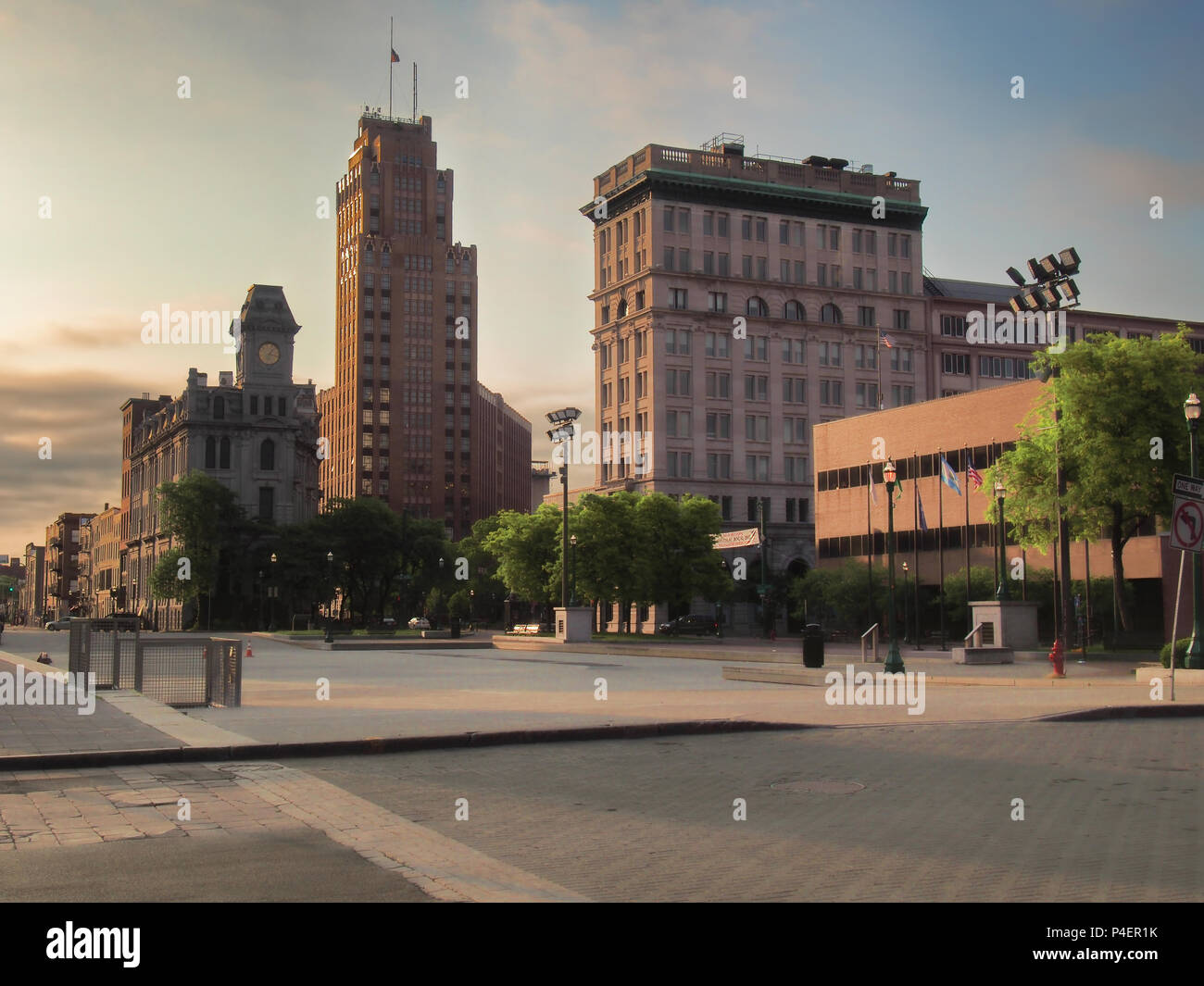 Syracuse, New York, USA. May  28, 2018. View of Clinton Square with fountain and ice skating area in downtown Syracuse, NY at sunrise - Stock Image