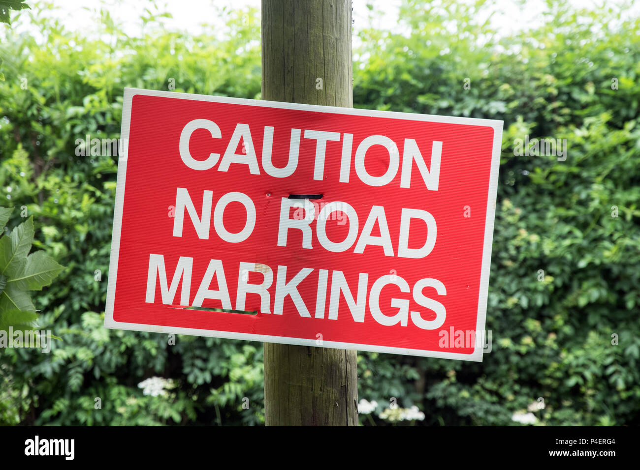 Road sign caution no road markings - Stock Image