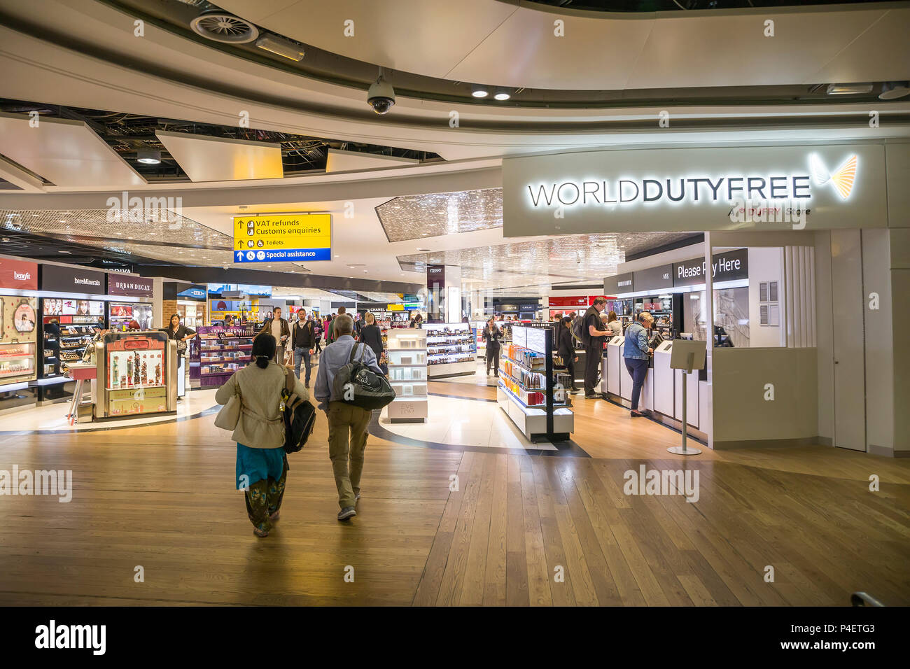 Duty free shopping with sign for VAT refunds and customs enquiries, Heathrow, London airport, UK - Stock Image