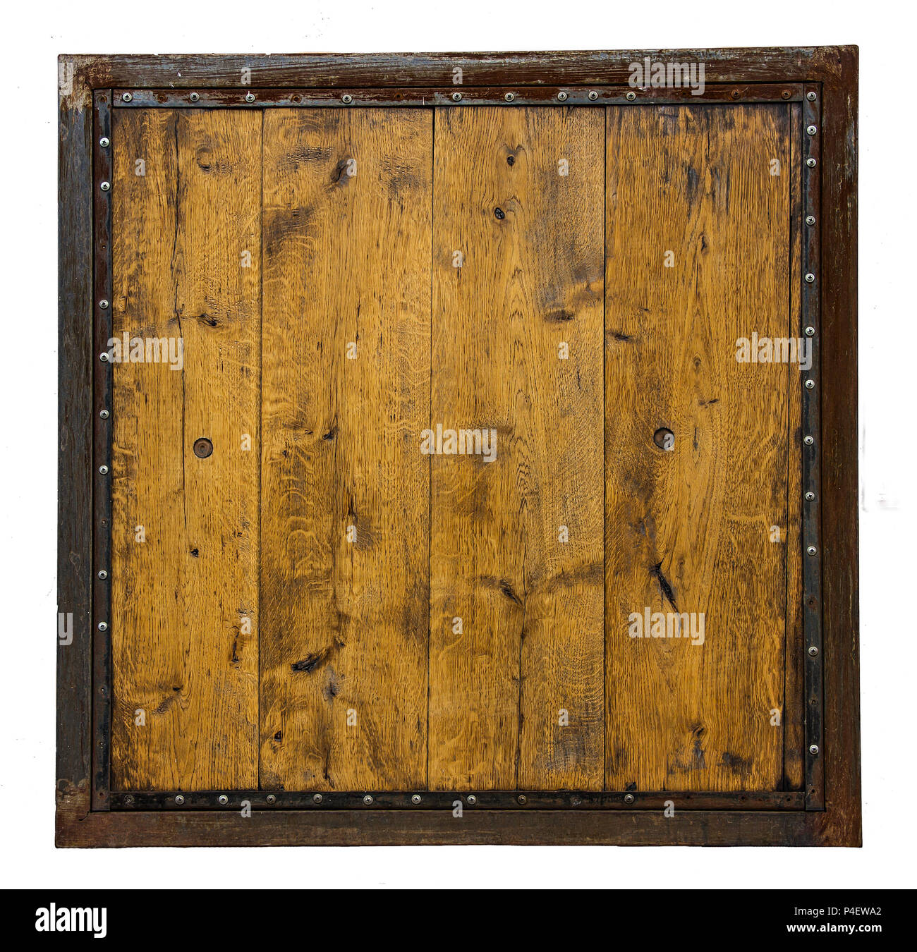 a wooden board made of wooden planks in a rusty metal frame with rivets isolated on white background - Stock Image