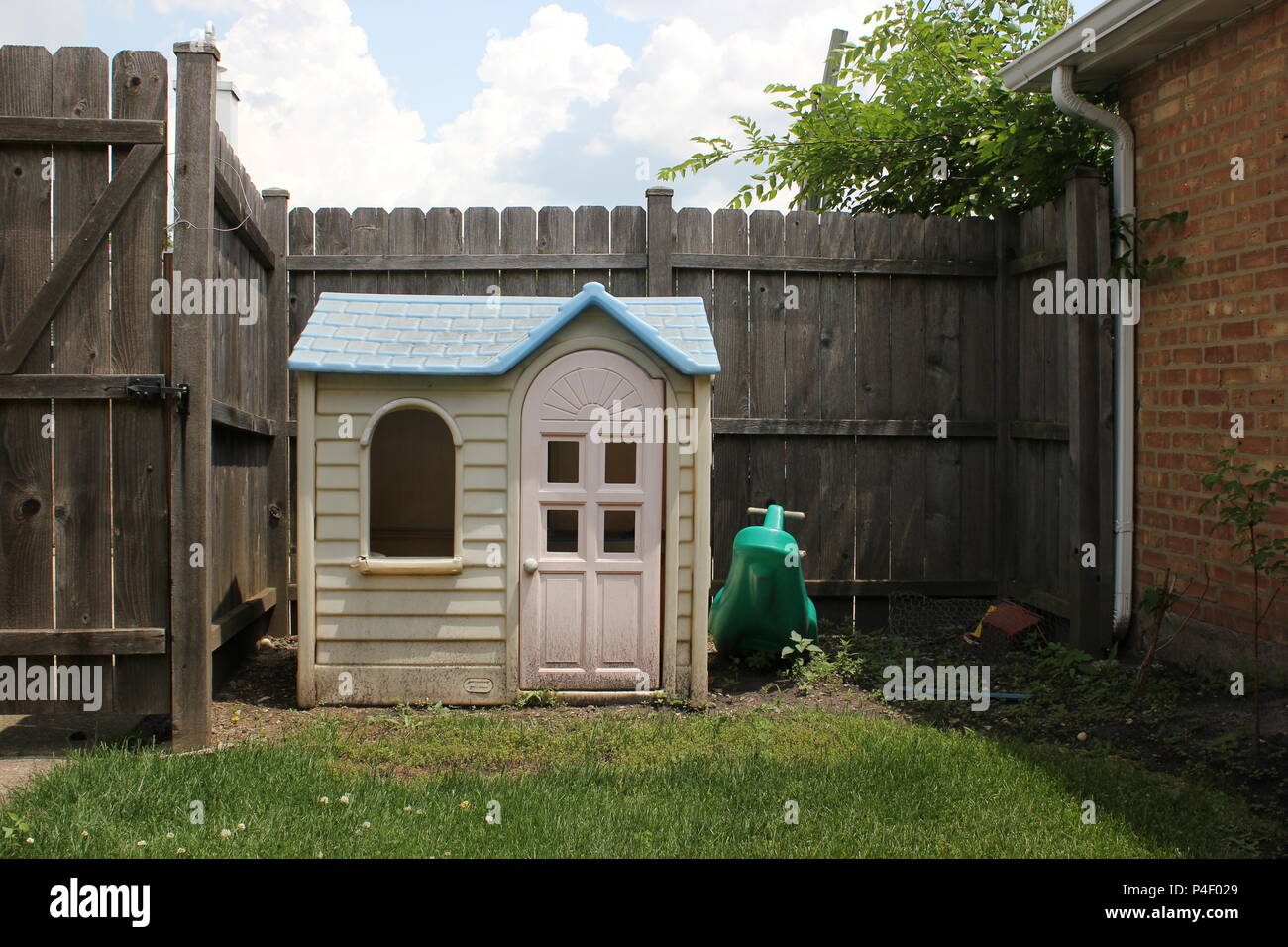 Children's play house and area at home in their own backyard. - Stock Image