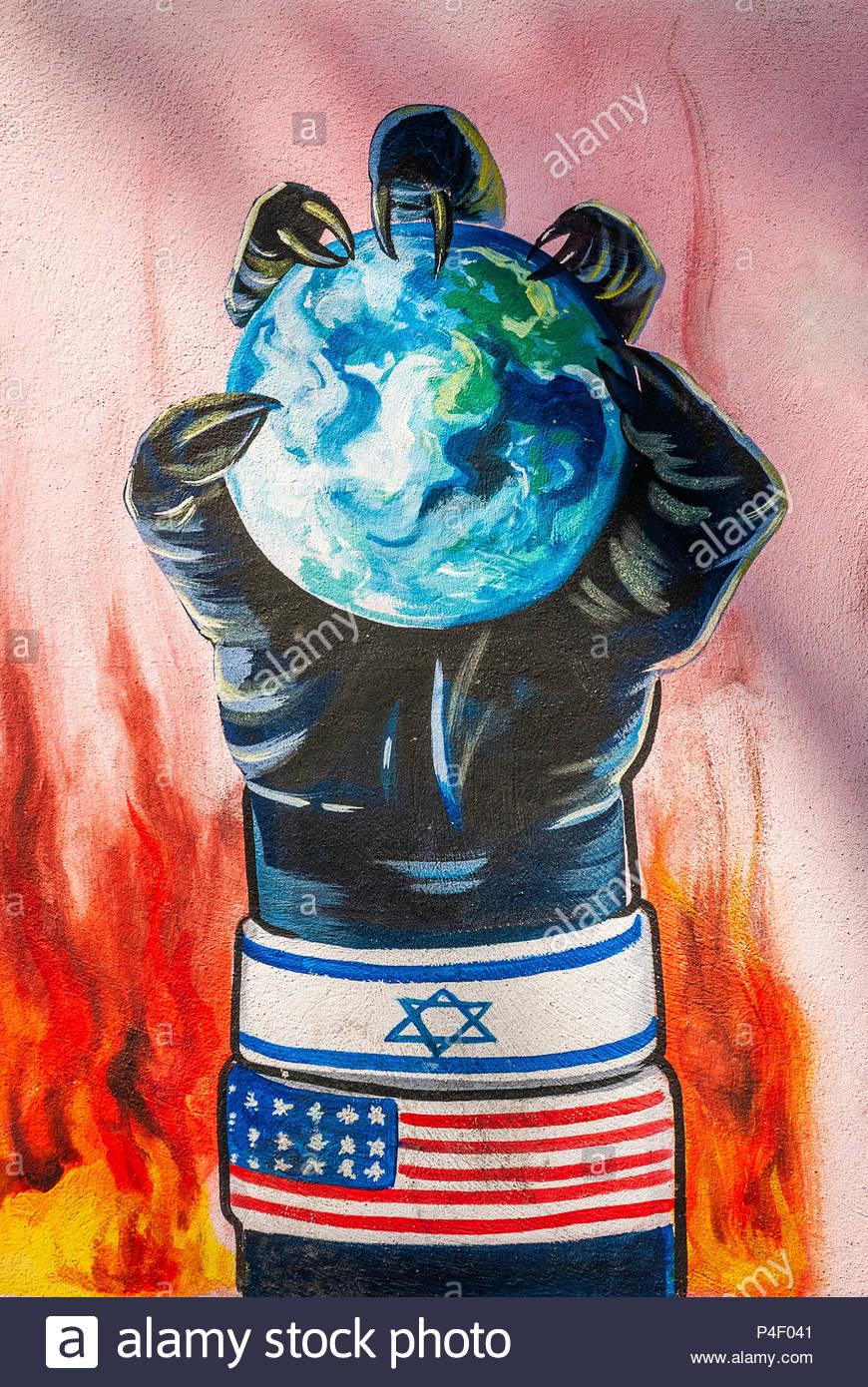 anti american and israel propaganda mural on tehran street iran outside former US embassy - Stock Image