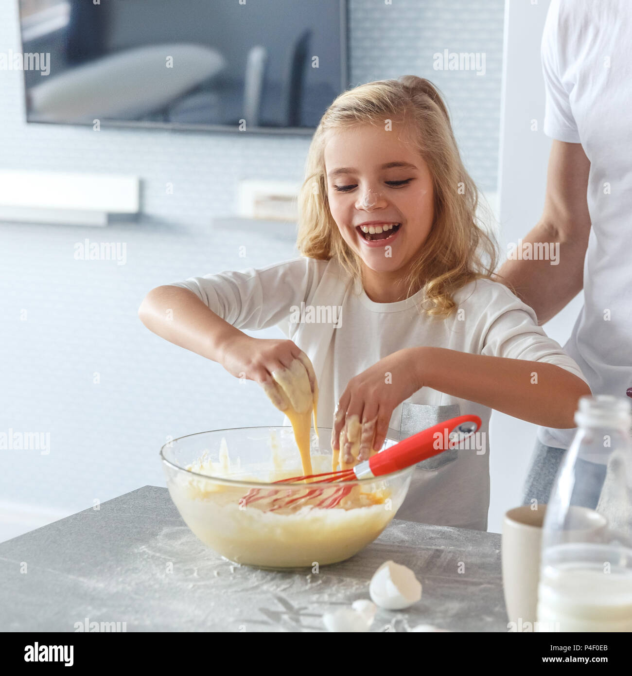 adorable little child cooking breakfast with father - Stock Image