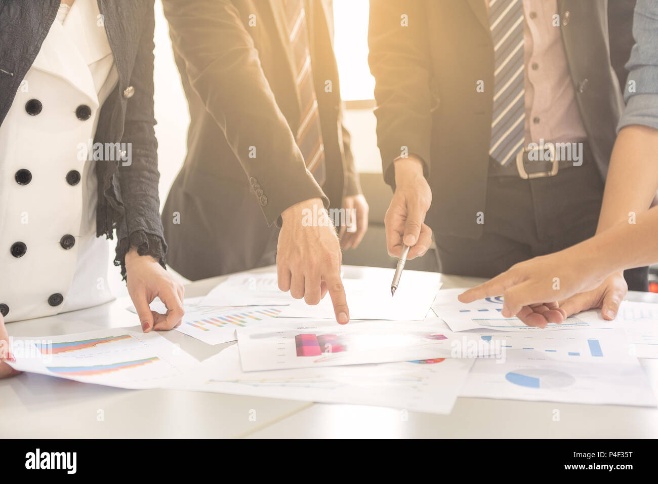 Businessman and woman are brainstorming on to creative new business idea as teamwork concept. - Stock Image