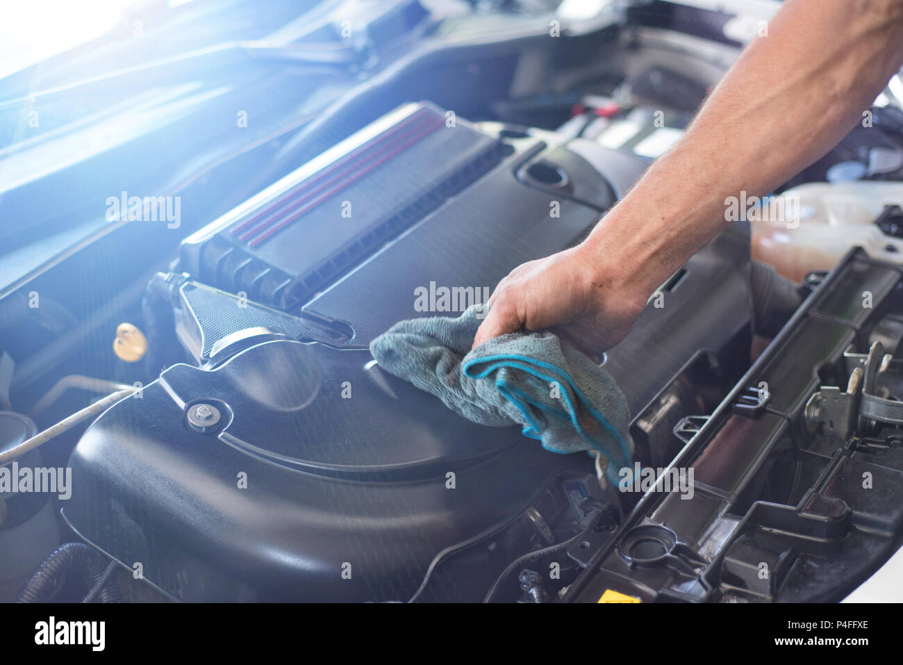 Mechanic cleaning car engine - Stock Image