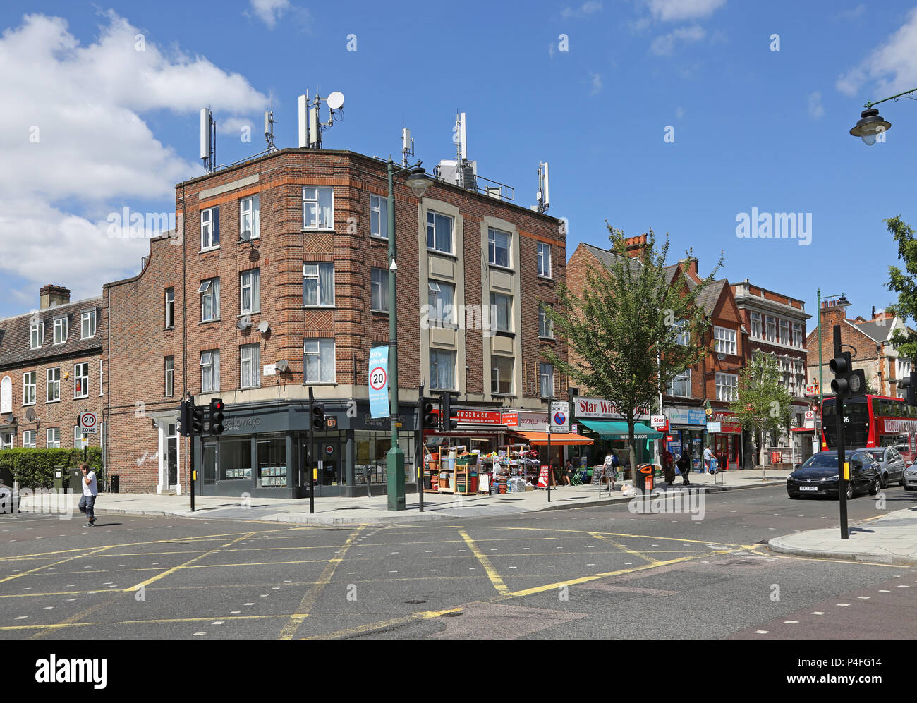 Norwood Road, South London, UK. A shopping street between Tulse Hill and West Norwood. Shows mobile phone antennas on a residential building. - Stock Image