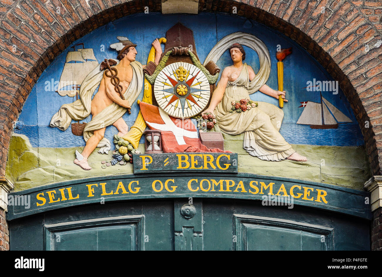 Old sign on wall, sail, flag and compass maker, Nyhavn (New Harbour) - Stock Image