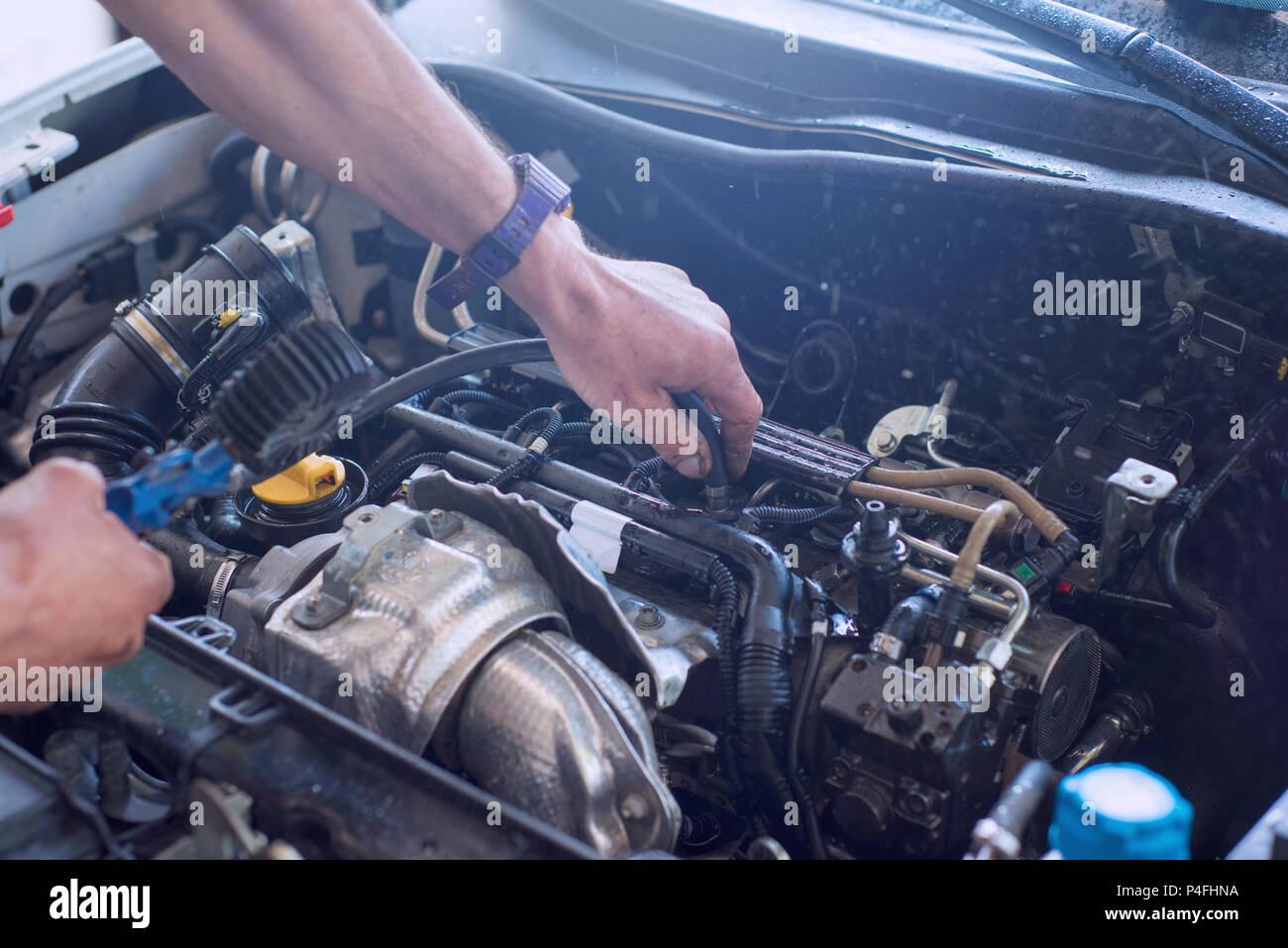Auto mechanic repairing car. Selective focus. - Stock Image