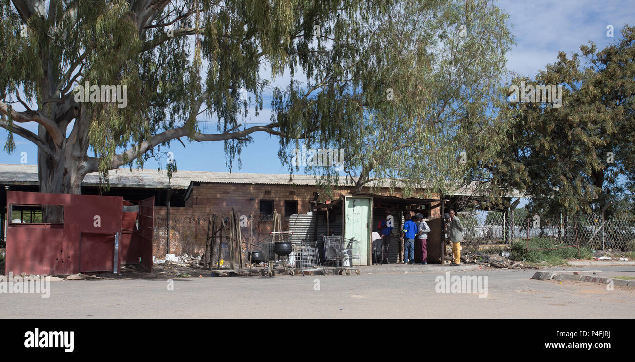 roadside rural African eating place or shebeen with black men in  a parking lot near to Mahikeng, North West Province, South Africa - Stock Image