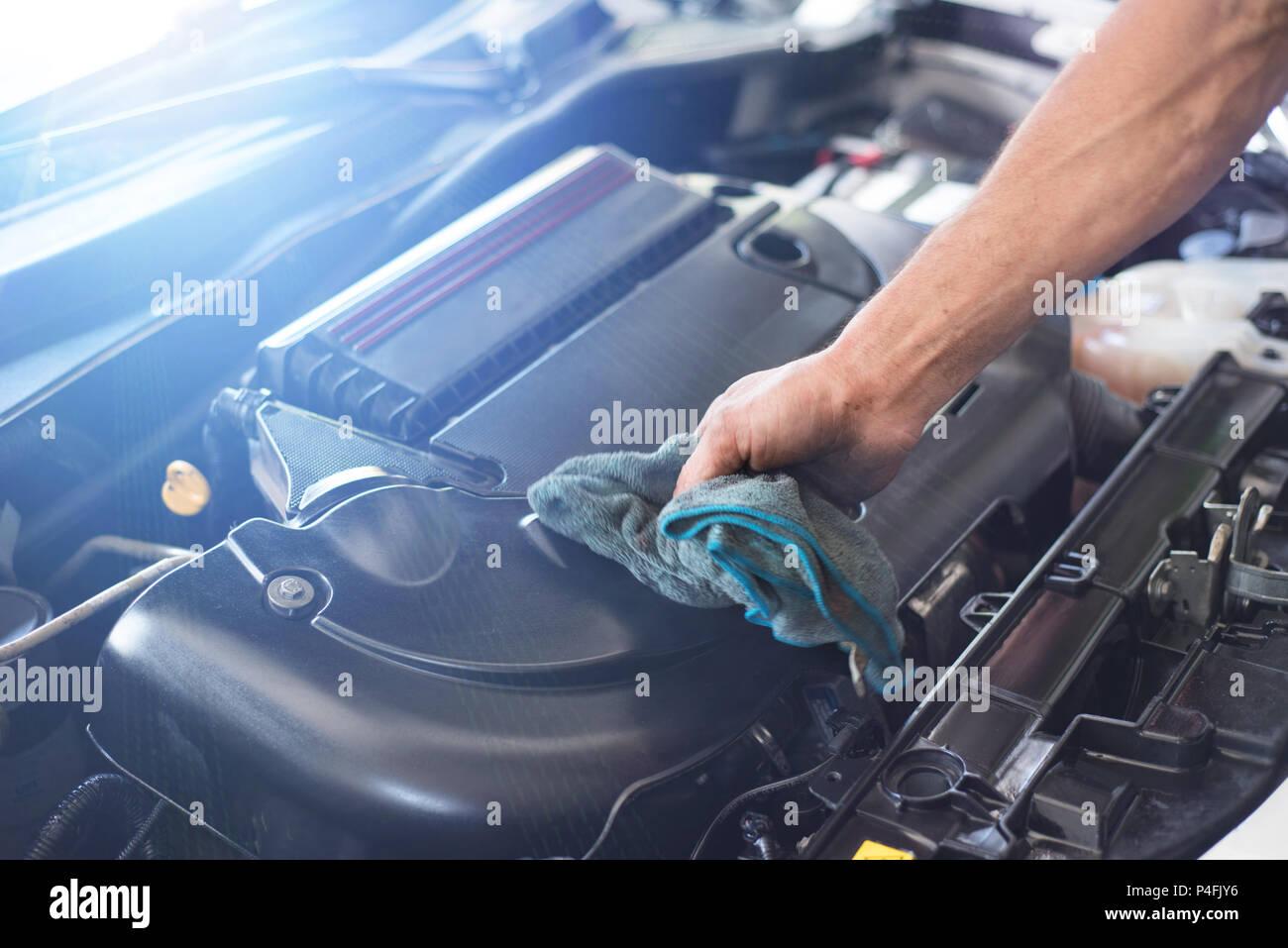 Mechanic cleaning car engine - Stock Image