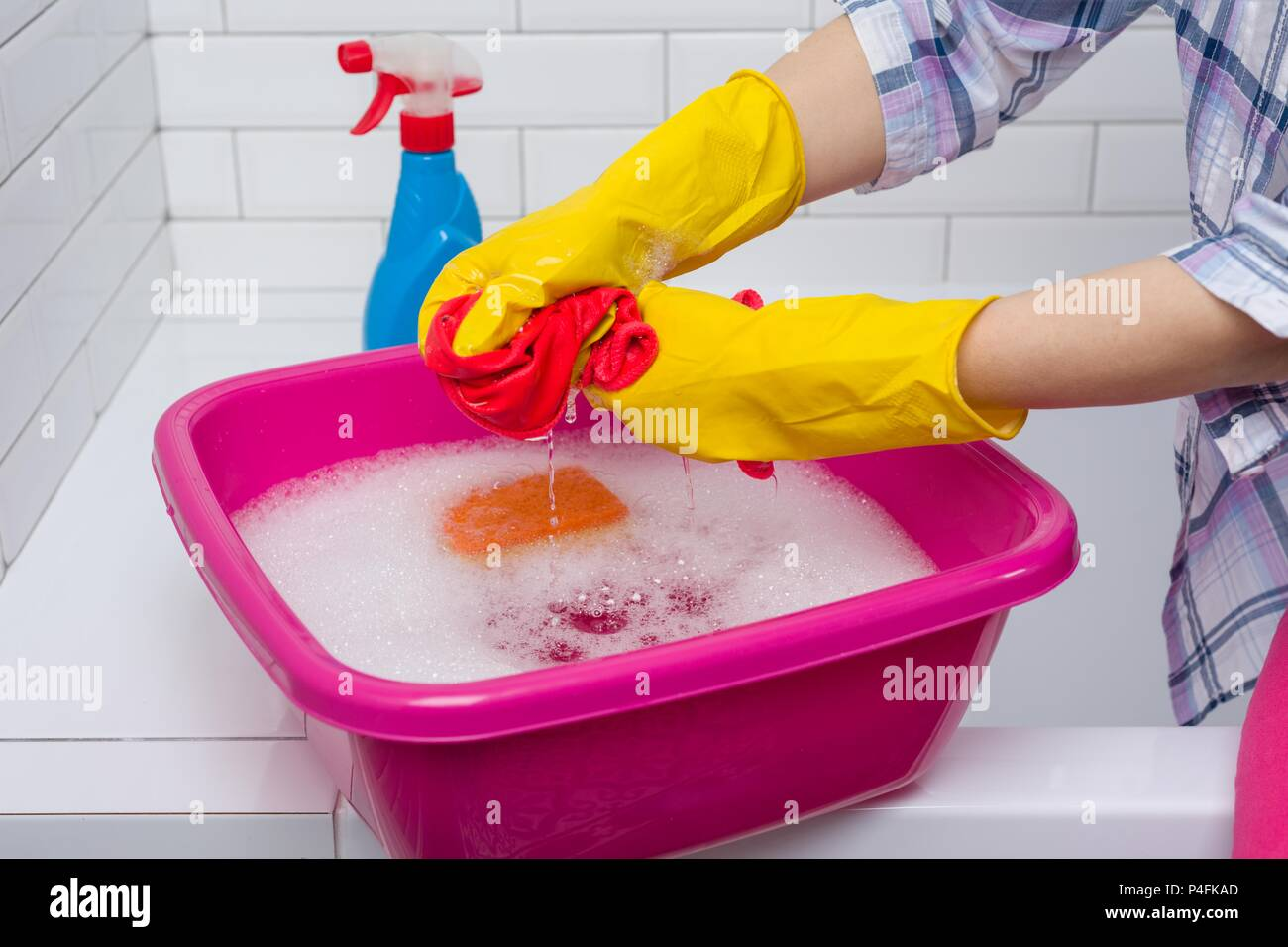 Housework and domestic lifestyle. Woman is cleaning in the bathroom. - Stock Image