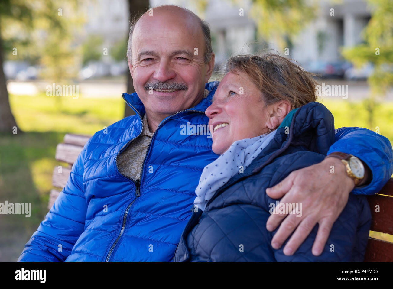Mature european couple walking on street at good weather in spring. Lovers spanding time together. - Stock Image