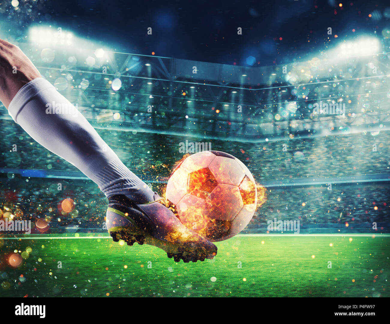 Soccer player with soccerball on fire at the stadium during the match - Stock Image