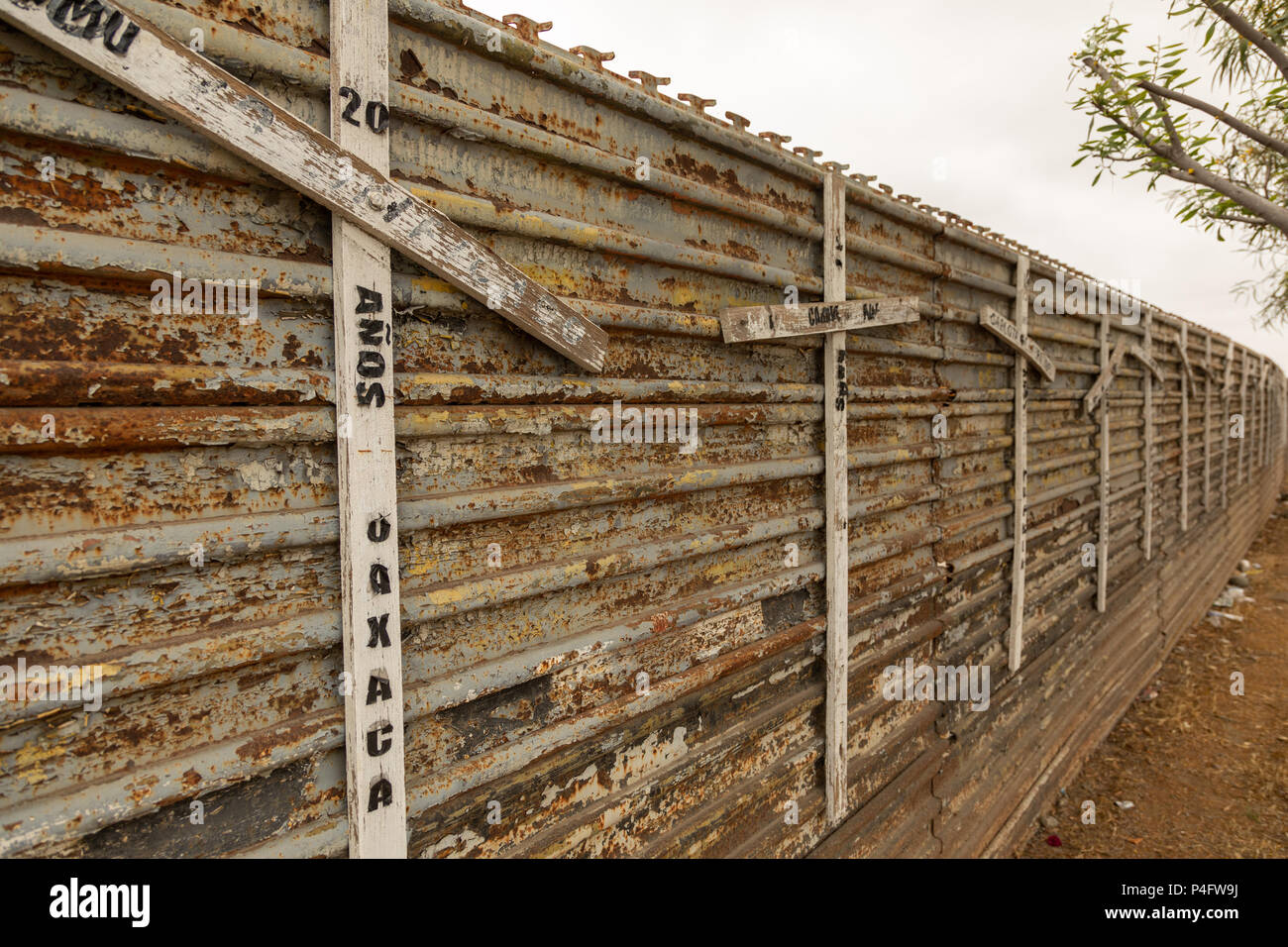 Memorials mark the border fence between Mexico and the USA to commemorate migrants who lost their lives whilst trying to cross to the USA. - Stock Image