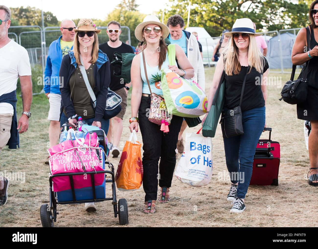 Kelly Connolly, Ley Tresadern, and Jayne Newman from London arrive on site at the Isle of Wight festival at Seaclose Park, Newport. Stock Photo