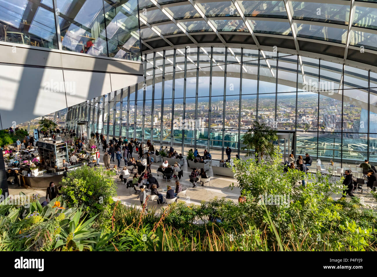 People enjoying the views and having drinks ant the Sky Garden at the top of 20 Fenchurch Street ,also known as The Walkie Talkie Building ,London - Stock Image