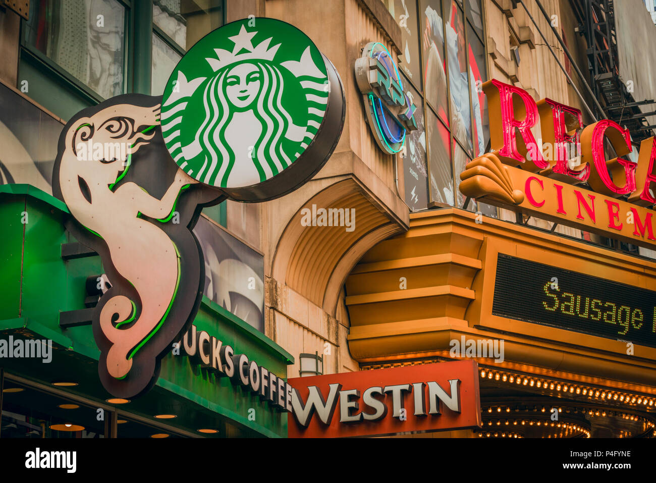 Jumbled signs and advertising on the streets of Manhattan, New York City - Stock Image