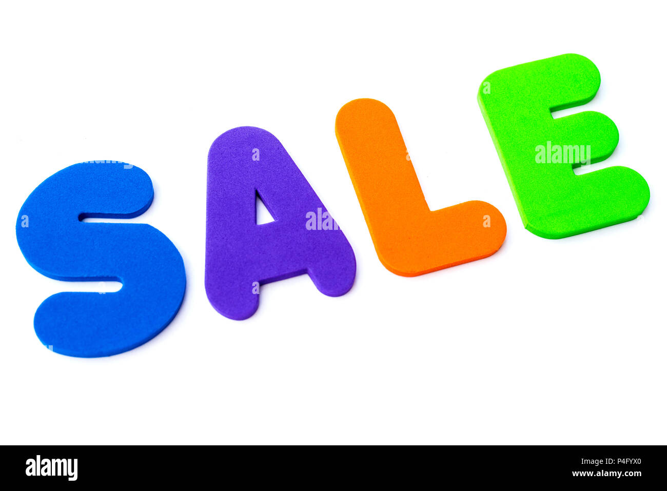 The word SALE over a plain white background. - Stock Image