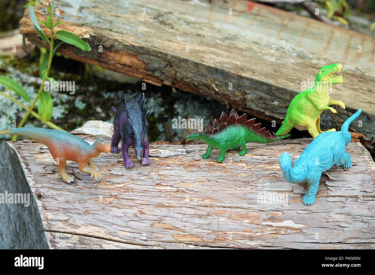 Plastic toy dinosaurs - News Concept - Stock Image