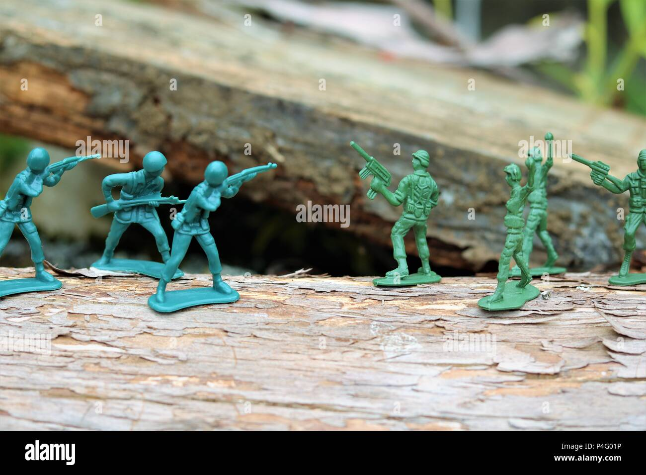 Plastic toy soldiers showing a battle scene - News Concept Stock Photo