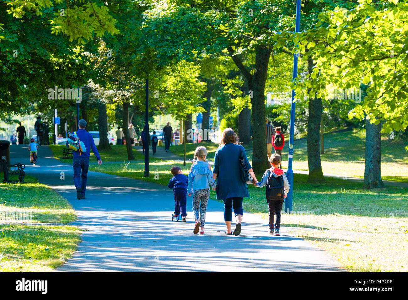 Aberystwyth, UK. 22 June 2018.Familes walking and cycling down Plas Crug park on a warm sunny morning in Aberystwyth Wales.  Temperatures are set to rise over the coming days, reaching the high 20's celsius by the middle of next week  photo © Keith Morris / Alamy Live News - Stock Image
