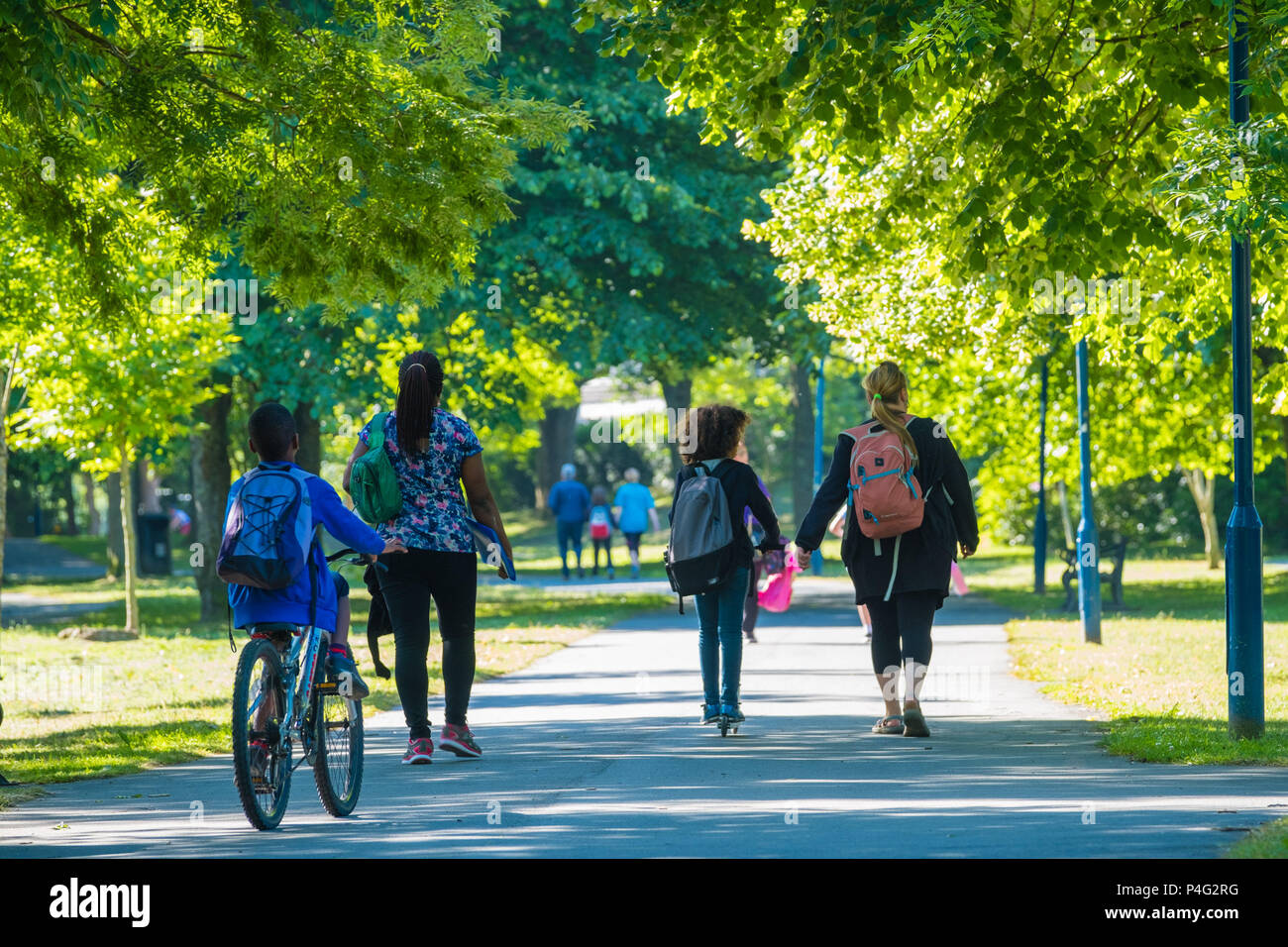 Aberystwyth, UK. 22 June 2018.  Familes walking and cycling down Plas Crug park on a warm sunny morning in Aberystwyth Wales.  Temperatures are set to rise over the coming days, reaching the high 20's celsius by the middle of next week  photo © Keith Morris / Alamy Live News - Stock Image