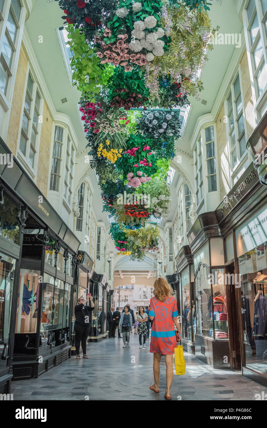 London, UK. 22nd June 2018. 2000 bespoke paper flowers by artist Mathilde Nivent creating a 'Hanging Garden of Flowers' in the Burlington Arcade in Mayfair -  this is part of Mayfair Art Weekend and coincides with the Royal Academy celebrating its 250th anniversary. Credit: Guy Bell/Alamy Live News - Stock Image