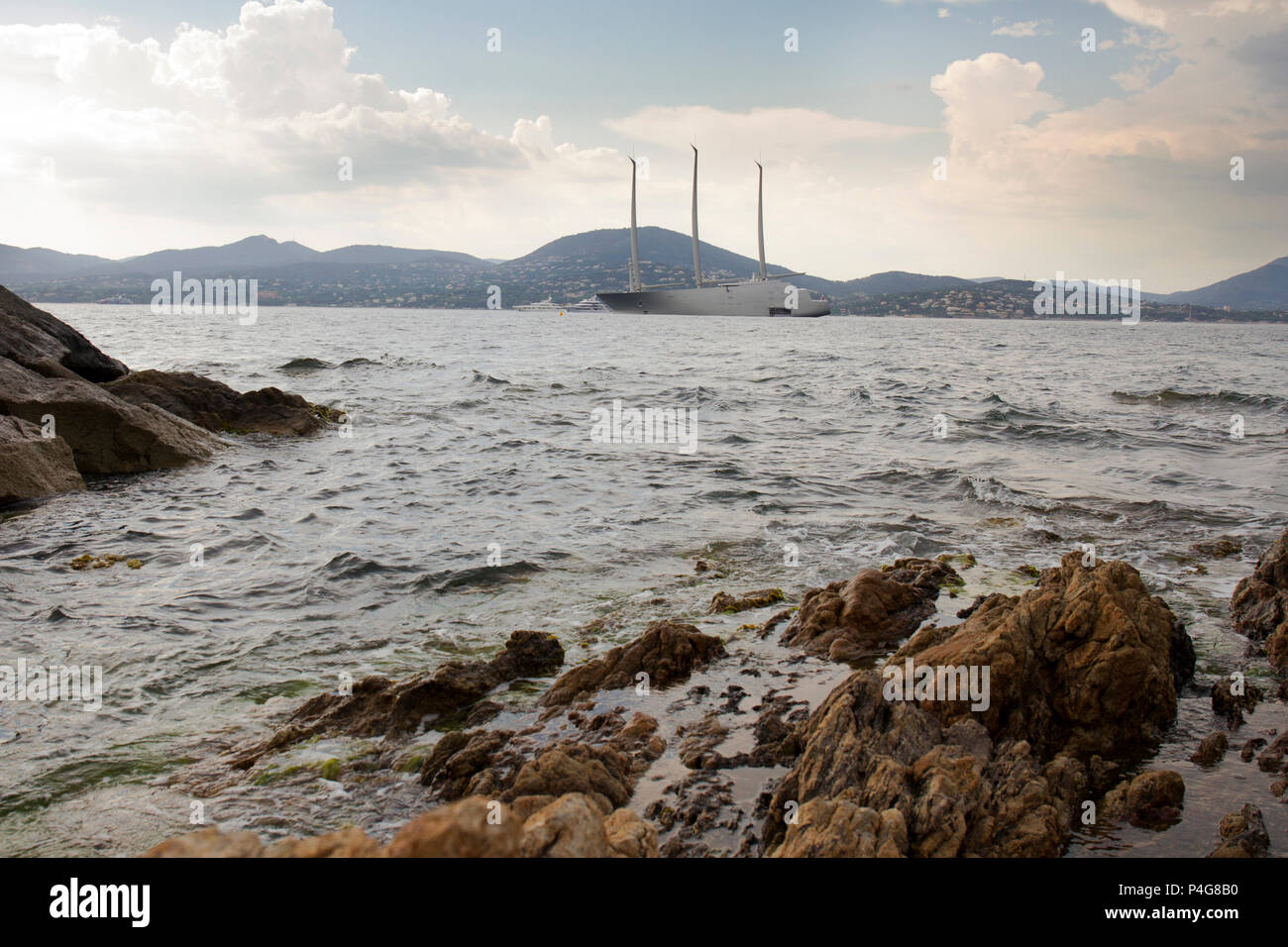 "Saint Tropez. France 21th, 2018.The big ""Sailing A"" in front of Saint Tropez Gulf. The  Sailing A is the most biggest sailing yacht in the world, builtd in Germany with the most advanced techonology. Lenght 142.81 meters; 12700 tons, designed by Phillippe Starck and Dolker & Voges. The owner of the ship is Andrei Melnichenko from Russia. Photo Alejandro Sala/Alamy Llive News Stock Photo"
