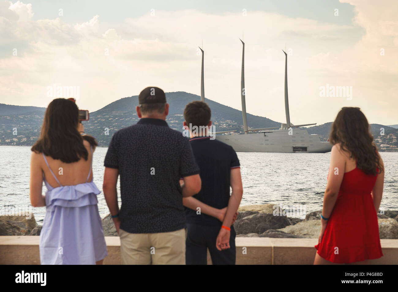 Saint Tropez. France 21th, 2018. People look at the big 'Sailing A' in front of Saint Tropez Gulf. The  Sailing A is the biggest sailing yacht in the world, build in Germany with the most advanced technology. Lenght 142.81 meters; 12700 tons, designed by Phillippe Starck and Dolker & Voges. The owner of the ship is Andrei Melnichenko from Russia. Photo Alejandro Sala/Alamy Llive News - Stock Image