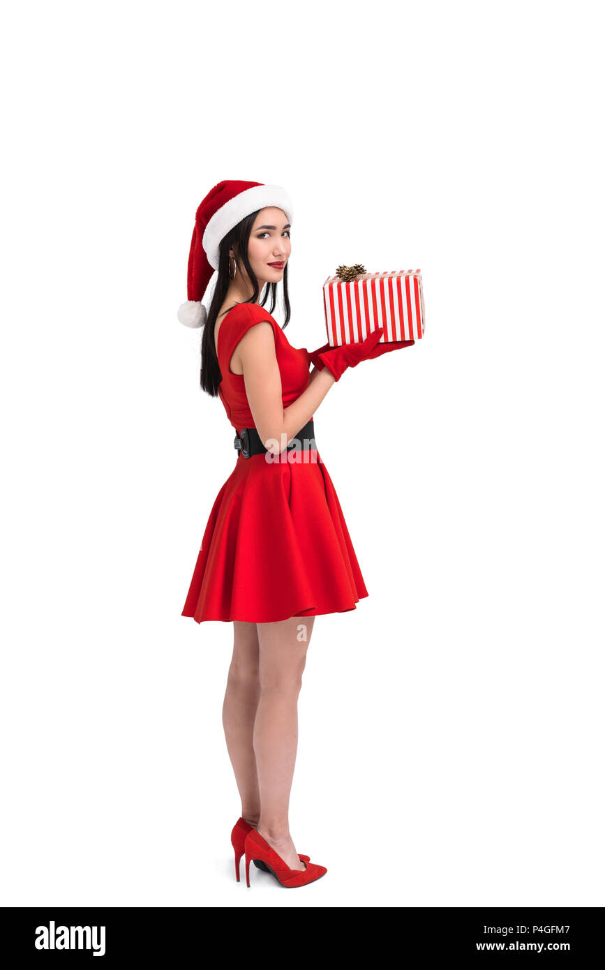 side view of smiling asian woman in santa costume with christmas ...