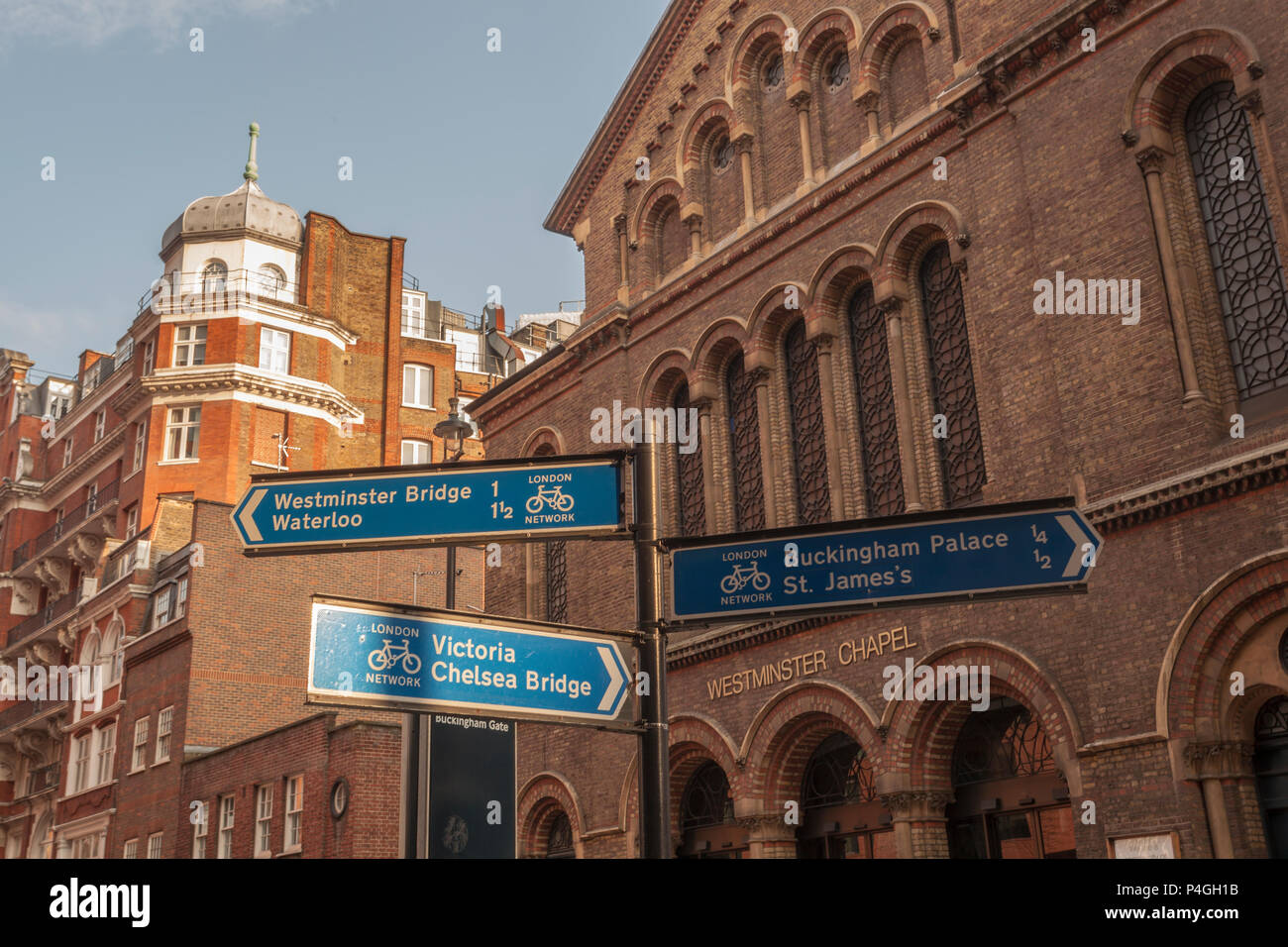 A sign post in London during a beautiful sunset outside Westminster Chapel - Stock Image