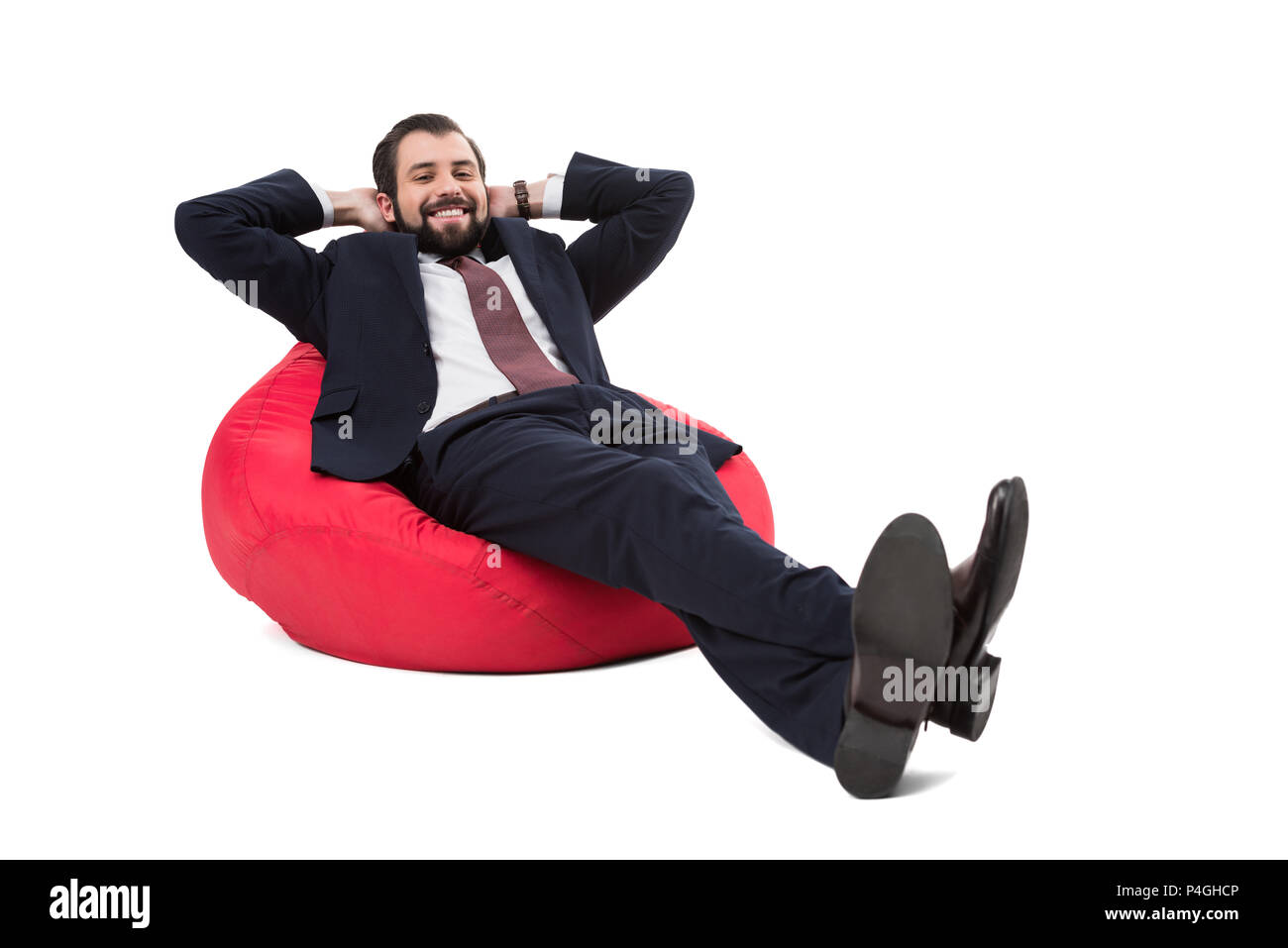 businessman relaxing on bean bag chair, isolated on white - Stock Image